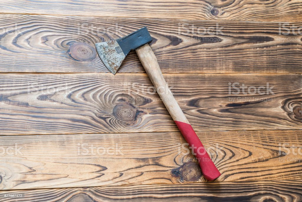 Big rusty ax on aged wooden background royalty-free stock photo
