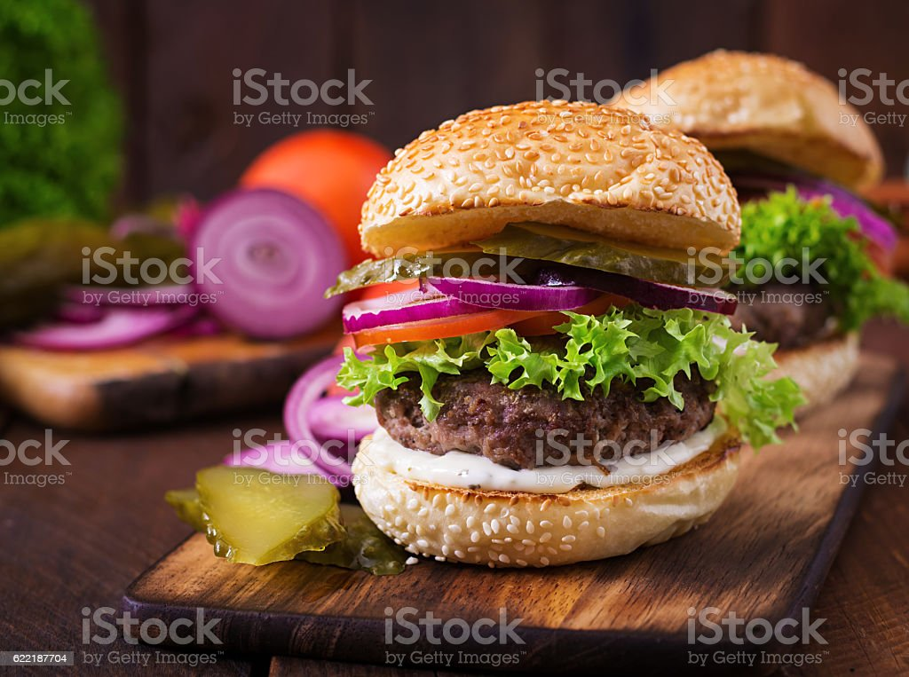 Big sandwich - hamburger burger with beef, pickles, tomato stock photo