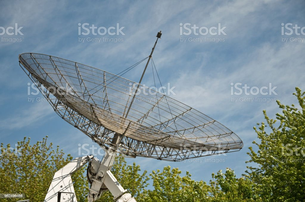 big satellite antenna on blue sky background - Royalty-free Antenna - Aerial Stock Photo