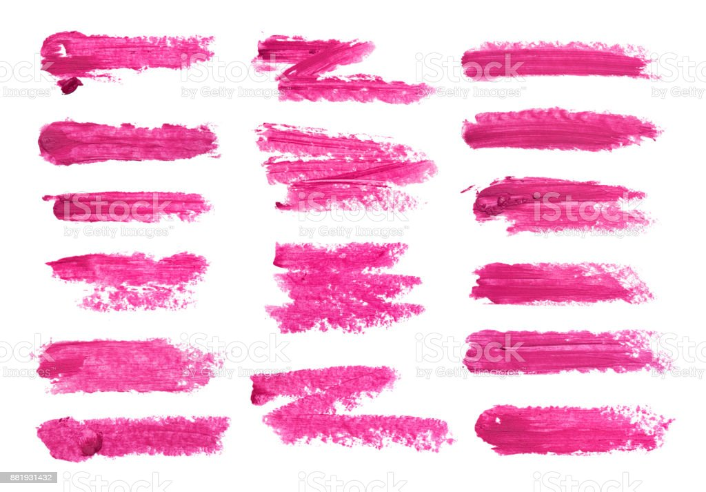 Gran conjunto de manchas de lápiz labial fucsia aislado sobre fondo blanco. Muestra del producto maquillaje manchado. - foto de stock