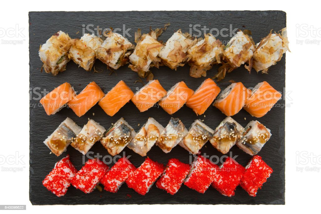 Big set of sushi roll on slate. Japanese food restaurant. Dark background. Top view stock photo