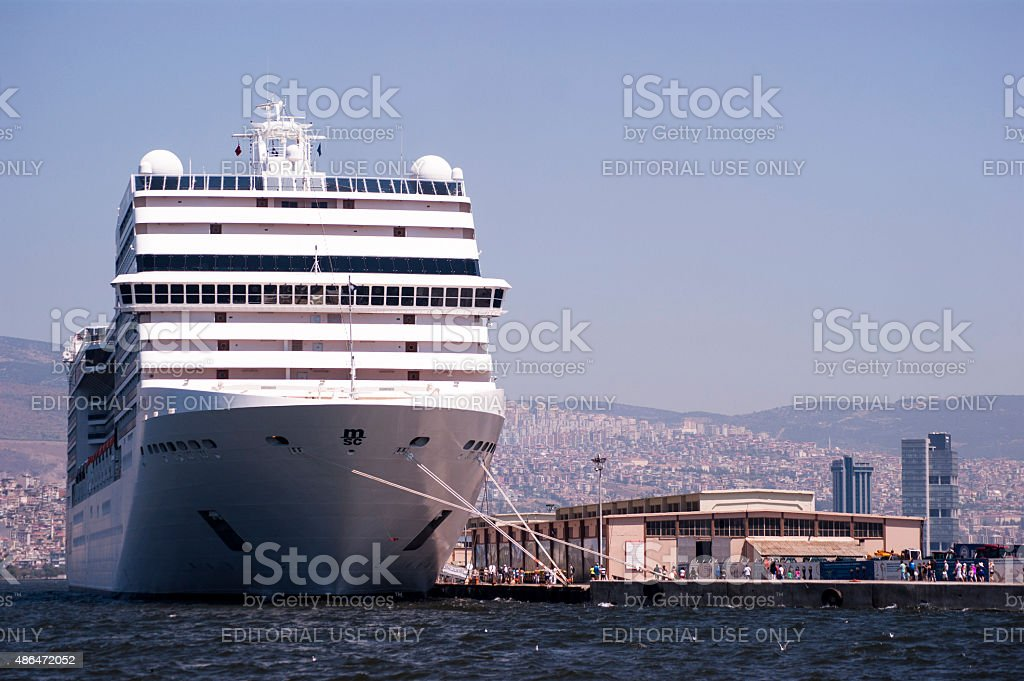 big ship and small people in alsancak port.