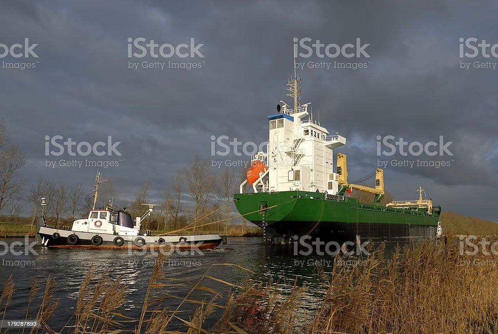 big ship sails a canal royalty-free stock photo