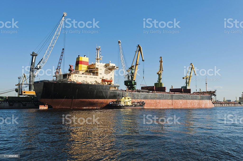 Big ship unloading in shipyard royalty-free stock photo
