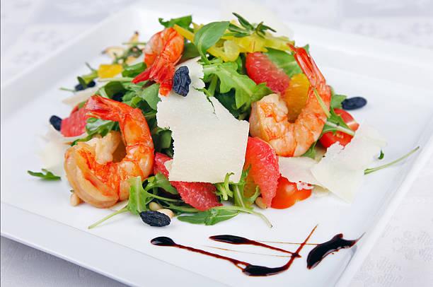 Big shrimp and green salad stock photo