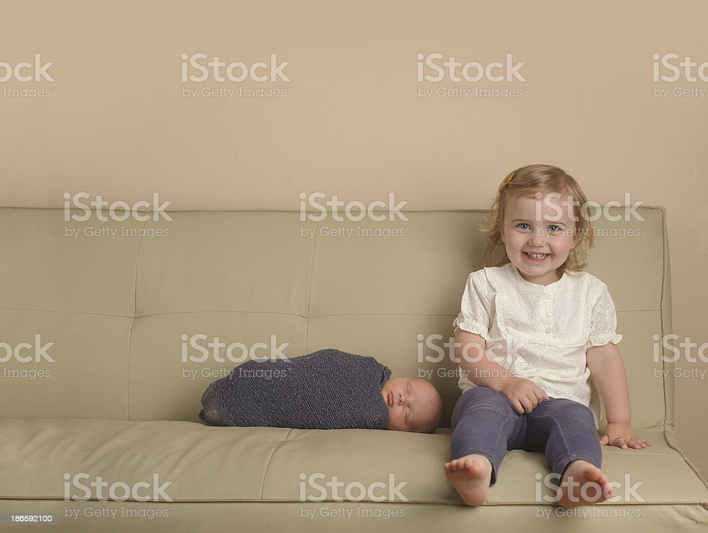 Big Sister Sitting on Couch With Brother royalty-free stock photo