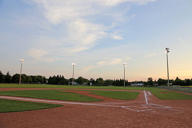 Big Sky Ball Field A wide angle shot of a baseball field. baseball diamond stock pictures, royalty-free photos & images