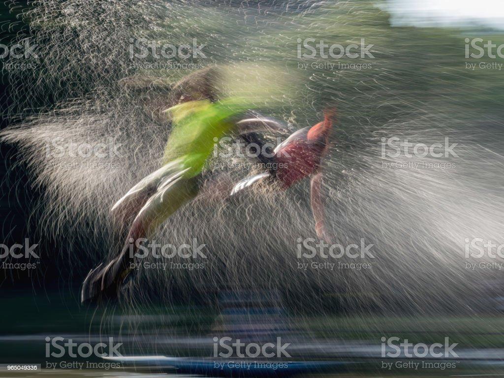 Big slide and jumping man zbiór zdjęć royalty-free