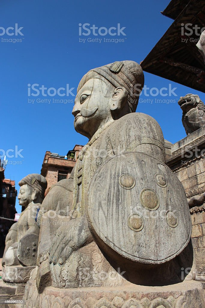 Big statues made of stone and shield military bunker. stock photo