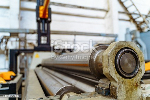 istock Big steel construction of tubes for cutting metal in workshop. 1129683661