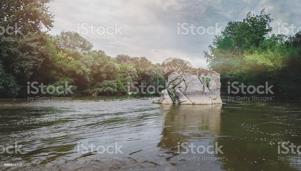 big stone in a river stock photo