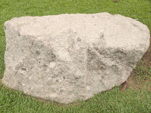 big stone on the grass - granite rock stock photos and pictures