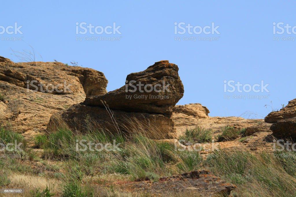 Big stone on the mountain slope stock photo