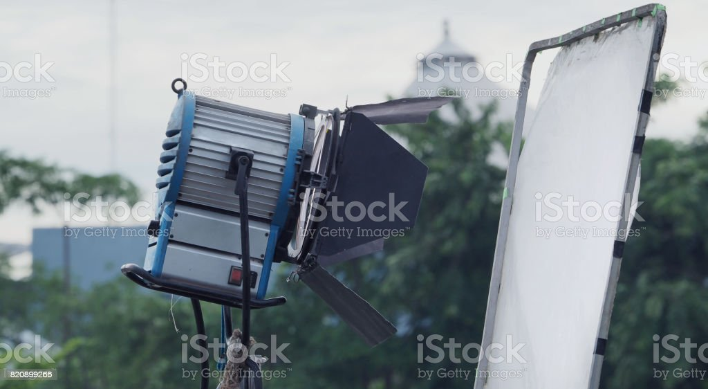 Big studio light and tripod for outdoor movie shooting stock photo