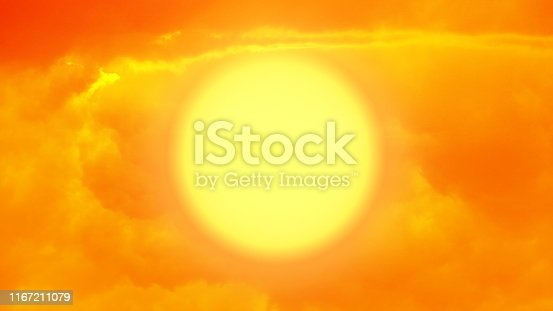 Big sun at sun set time with some clouds, Abstract apocalyptic background - big glowing sun at evening time, dramatic sunset, dark red clouds, nature background. hell or religion concept.