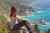 Big Sur road trip, California Coastline. Vista point, woman enjoying the view
