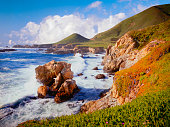 Big Sur Coast Of California With Waves  Of The Pacific Ocean Crashing Against Rocky Shores