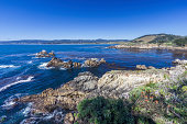 Big Sur Coast Of California With Waves Crashing Against Rocky Shores