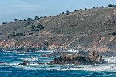 High angle view of rocky shore along Big Sur coast.\n\nTaken along Big Sur Coast, Big Sur, California, USA.