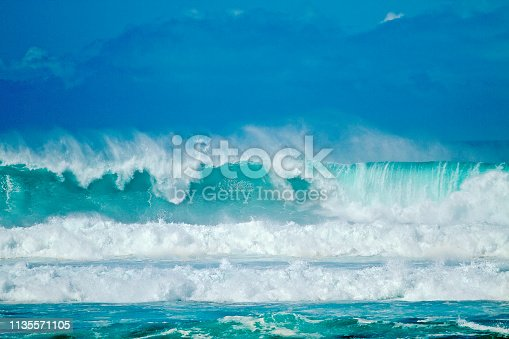 Big Waves with mountains, cloudscape