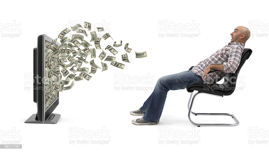 Big Surprise On TV A man sitting on armchair and cash (one hundred-dollar bills) flowing out of a flat screen television. He is amazed and scared. Isolated on white background. Adult Stock Photo