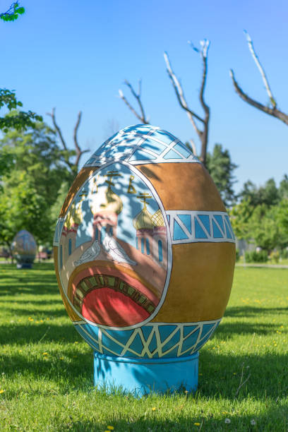 Big symbolic easter egg on green grass stock photo