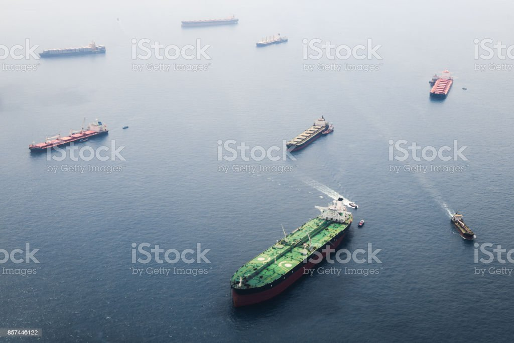 Big tanker with two helicopter platforms stay on anchor stock photo