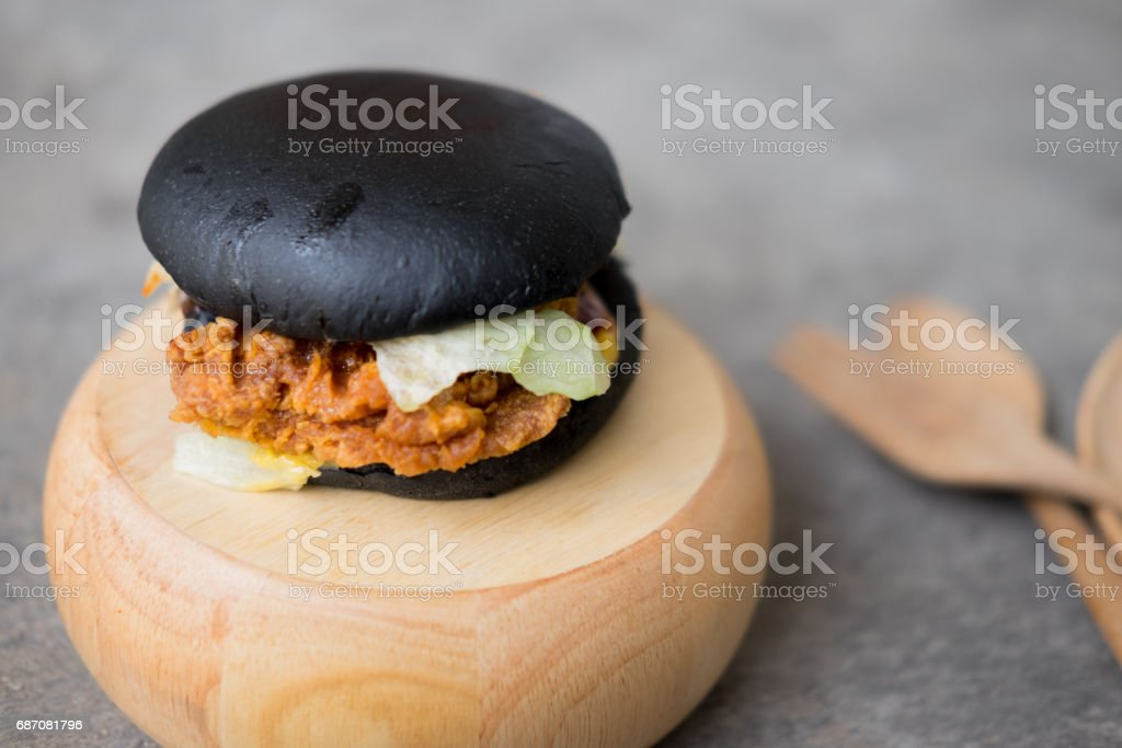 Big Tasty Black Burger In Fast Food Restaurant Menu Food Close Up Lizenzfreies Stock