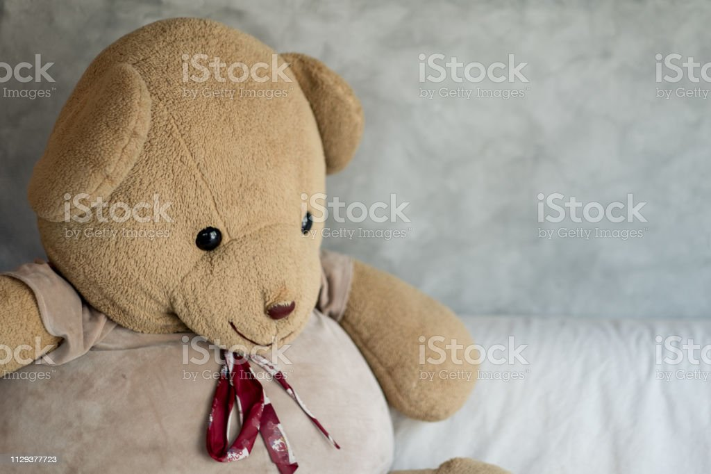Big teddy bear on with sofa in loft style room