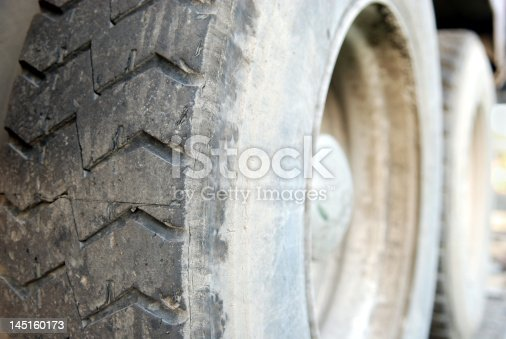 A tire from a big truck