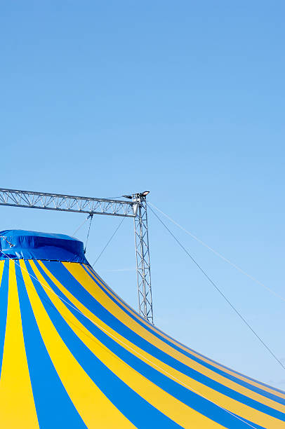 big top circus tent against blue sky - tent stock photos and pictures