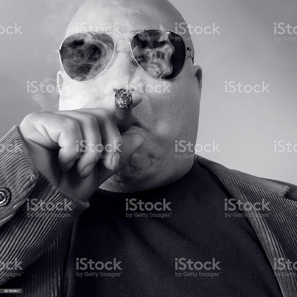Big tough boss wearing sunglasses and smoking a cigar stock photo