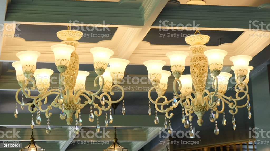 Big tow vintage chandelier decoration in hotel stock photo