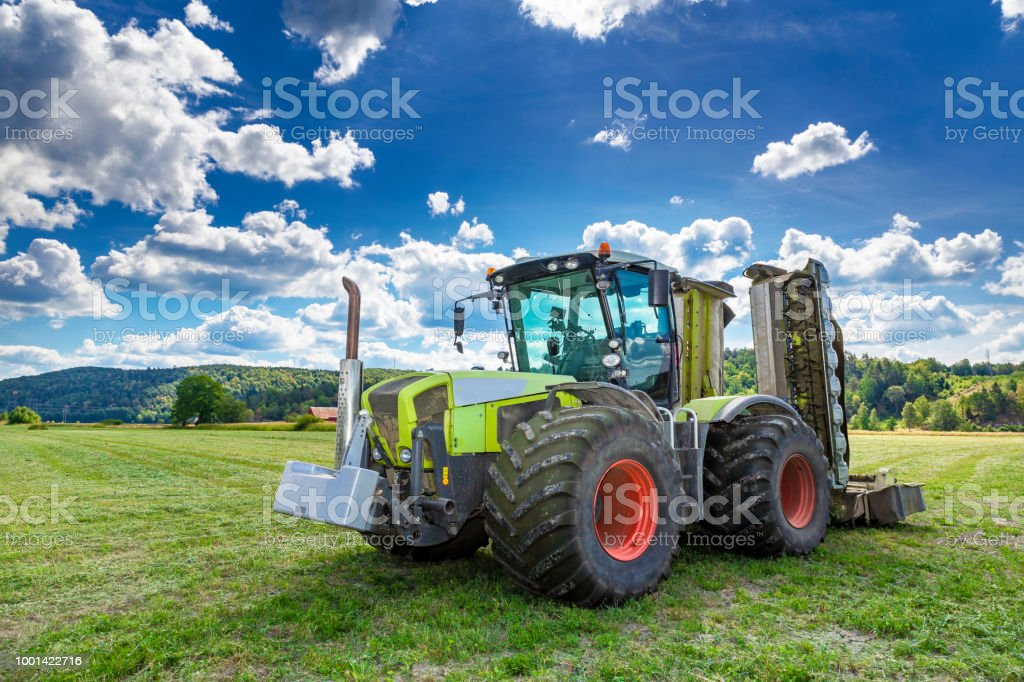 Big tractor with mower stock photo