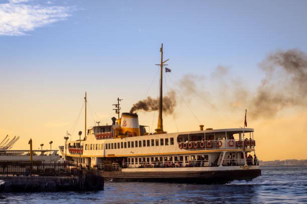 Big traditional Istanbul passenger ferryboat approaching to Kadikoy pier stock photo