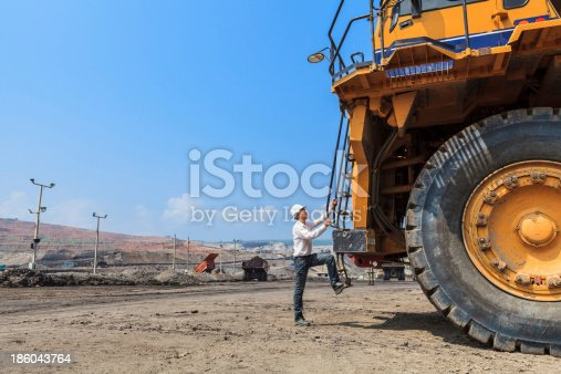 istock Big Truck and Worker 186043764