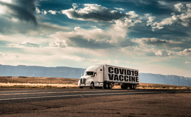 big truck delivering the vaccine for covid stock photo