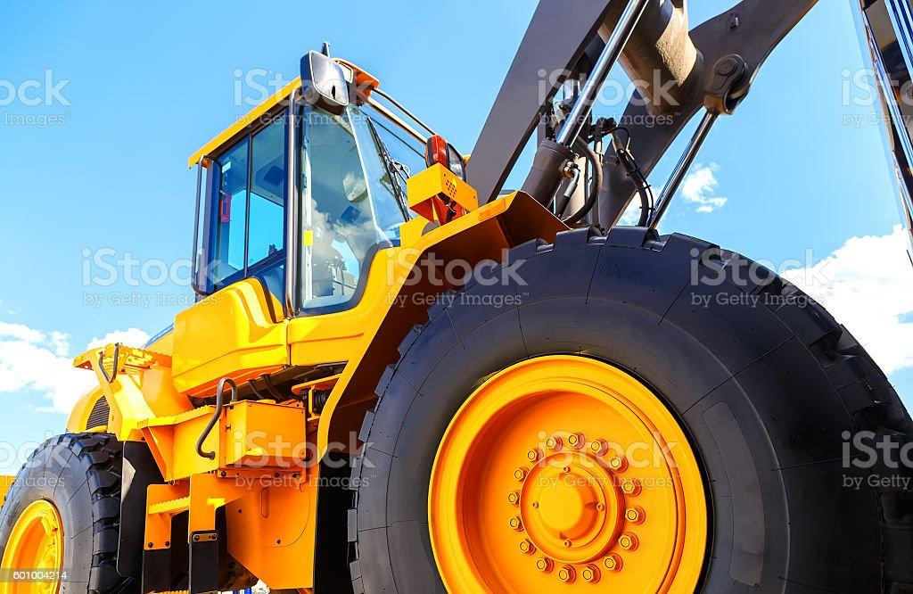 big truck wheel closeup object. bulldozer closeup wheels stock photo