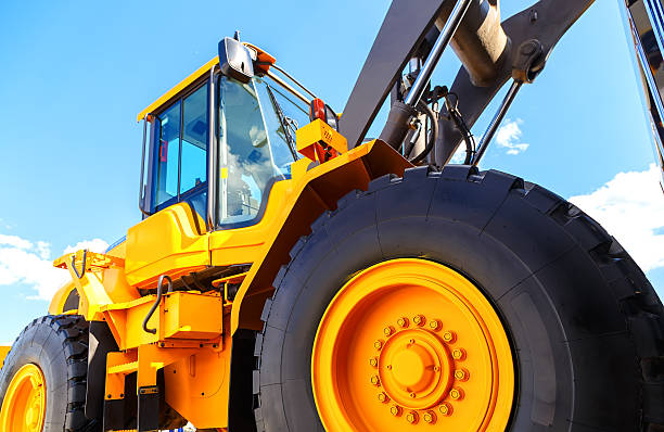 big truck wheel closeup object. bulldozer closeup wheels stock photo