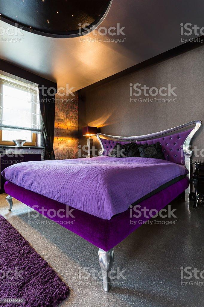 Big violet bed stock photo