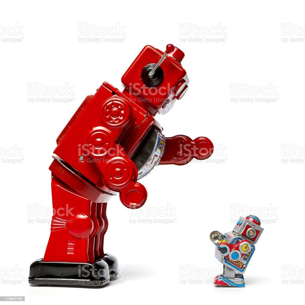 Big vs. Small - Retro Tin Toy Robot stock photo