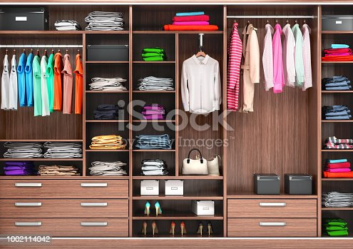 istock Big wardrobe with different clothes for dressing room. 3d illustrations 1002114042