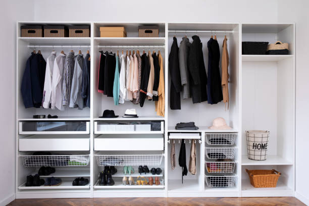 Big wardrobe with different clothes for dressing room – zdjęcie