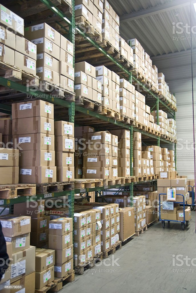 big warehouse logistics packets stock photo