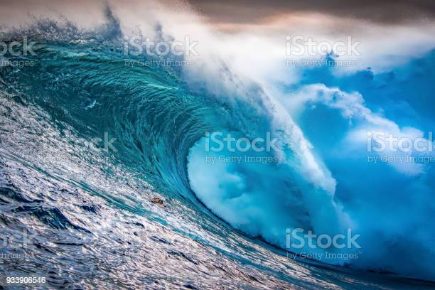 Photo of Big wave breaking at sunset