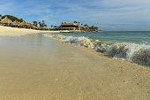 Big wave in Caribbean sea is breaking the coast. Eagle Beach of Aruba Island.  Beautiful nature background.