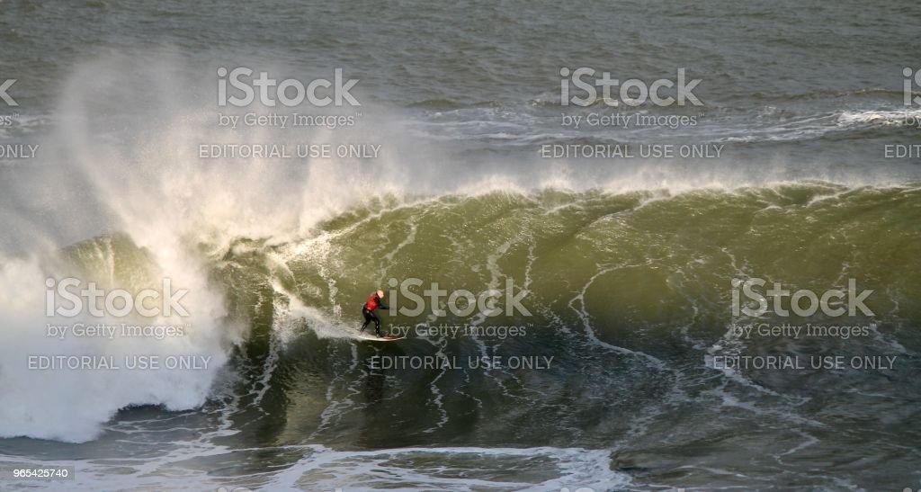 Big Wave Rider at sunset royalty-free stock photo