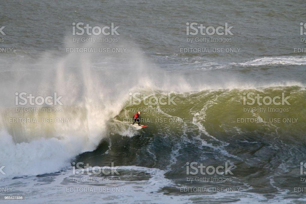 浪車手在日落 - 免版稅一個人圖庫照片