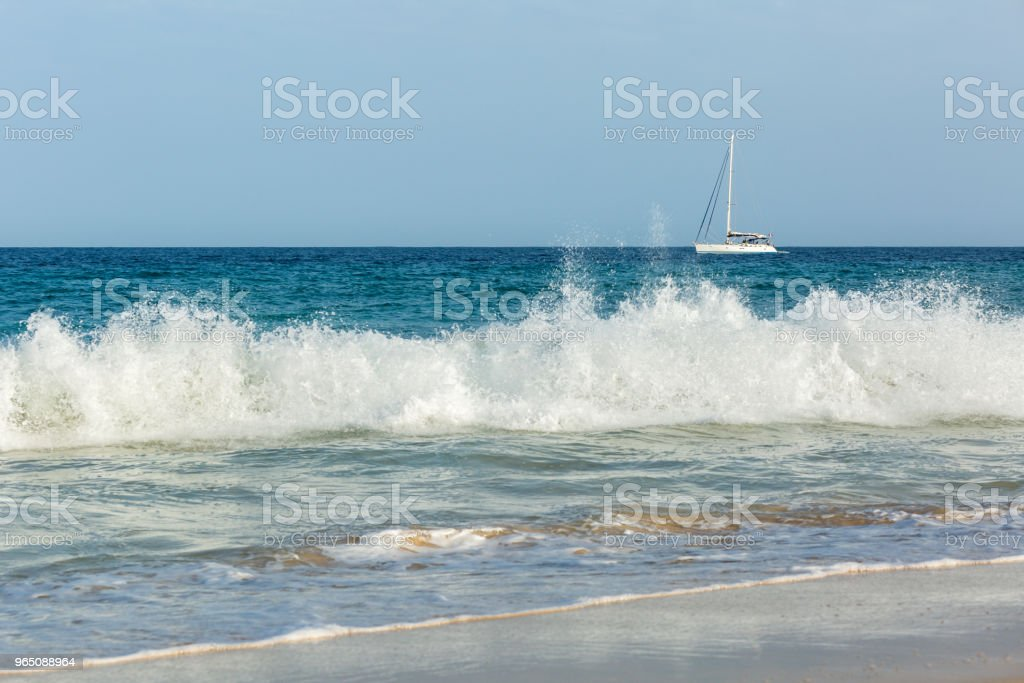 Big waves and white yacht royalty-free stock photo