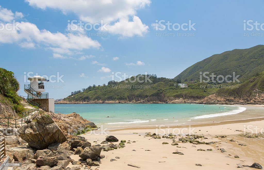 Big waves beach in Hong Kong Big waves beach is part of Shek O country park in Hong Kong island. This is the end of the very popular Dragon's Back Trail. 2015 Stock Photo